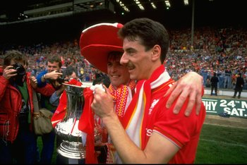 May 1986:  Kenny Dalglish (left) and Ian Rush of Liverpool pose with the trophy after the FA Cup final against Everton at Wembley Stadium in England. Liverpool won the match 3-1. \ Mandatory Credit: David  Cannon/Allsport