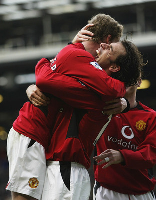 MANCHESTER - NOVEMBER 23:  Ole Gunnar Solskjaer of Man Utd celebrates with Ruud Van Nistelrooy after scoring the fifth goal during the Manchester United v Newcastle United FA Barclaycard Premiership match at Old Trafford on November 23, 2002 in Manchester