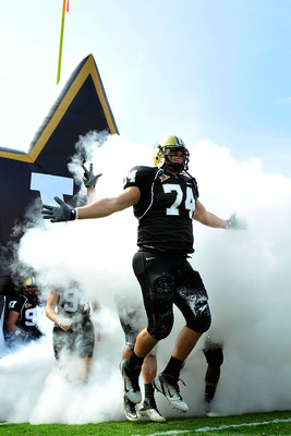 NASHVILLE, TN - SEPTEMBER 17:  T.J. Greenstone #74 of the Vanderbilt Commodores takes the field for a game against the Ole Miss Rebels at Vanderbilt Stadium on September 17, 2011 in Nashville, Tennessee.  (Photo by Grant Halverson/Getty Images)