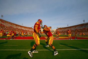 LOS ANGELES, CA - SEPTEMBER 17: Offensive linemen Jeremy Galten #74 and Nathan Guertler #76 of the USC Trojans  warmup for the game with the Syracuse Orangemen at the Los Angeles Memorial Coliseum on September 17, 2011 in Los Angeles, California.  (Photo
