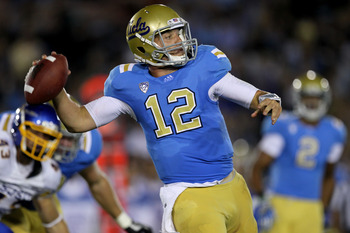 PASADENA, CA - SEPTEMBER 10:  Quarterback Richard Brehaut #12 of the UCLA Bruins throws a pass against the San Jose State Spartans at the Rose Bowl on September 10, 2011 in Pasadena, California.  UCLA won 27-17. (Photo by Stephen Dunn/Getty Images)