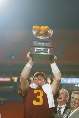 MIAMI - JANUARY 2:  Carson Palmer #3 of USC holds aloft the MVP trophy after the victory over Iowa in the FedEx Orange Bowl on January 2, 2003 at Pro Player Stadium in Miami, Florida.  Palmer led scoring drives of 79, 80, 99, 85 and 61 yards as USC defeat