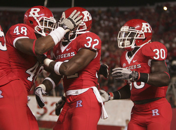 PISCATAWAY, NJ - SEPTEMBER 1: Duron Harmon #32 of Rutgers Scarlet Knights is congratulated by teammates Marcus Thompson #48 and Ben Martin #30 after Harmon returned an interception for a touchdown against North Carolina Central eagles during a college foo