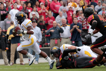 COLLEGE PARK, MD - SEPTEMBER 17:  Running back Vernard Roberts #9 of the West Virginia Mountaineers rushes for a touchdown against the Maryland Terrapins during the first half at Byrd Stadium on September 17, 2011 in College Park, Maryland.  (Photo by Rob