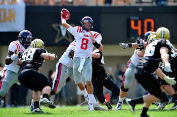 NASHVILLE, TN - SEPTEMBER 17:  Quarterback Zack Stoudt #8 of the Ole Miss Rebels stands in the pocket agianst the Vanderbilt Commodores at Vanderbilt Stadium on September 17, 2011 in Nashville, Tennessee.  (Photo by Grant Halverson/Getty Images)