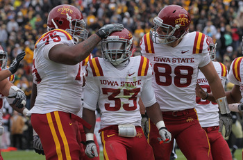 BOULDER, CO - NOVEMBER 13:  Alexander Robinson #33 of the Iowa State Cyclones celebrates his eight yard touchdown run in the second quarter with his teammates against the Colorado Buffaloes at Folsom Field on November 13, 2010 in Boulder, Colorado. Colora