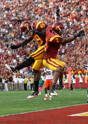 LOS ANGELES, CA - SEPTEMBER 17:  Robert Woods #2 of the USC Trojans celebrates with tight end Christian Thomas #89 after scoring on a 31 yard touchdown catch in the second quarter against the Syracuse Orangemen at the Los Angeles Memorial Coliseum on Sept