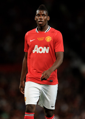MANCHESTER, ENGLAND - AUGUST 05:  Paul Pogba of Manchester United looks on during Paul Scholes' Testimonial Match between Manchester United and New York Cosmos at Old Trafford on August 5, 2011 in Manchester, England.  (Photo by Chris Brunskill/Getty Imag