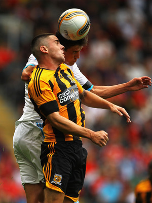 HULL, ENGLAND - JULY 23:  Robert Brady of Hull City and Jack Robinson of Liverpool challenge for the ball during the Pre Season Friendly match between Hull City and Liverpool at KC Stadium on July 23, 2011 in Hull, England.  (Photo by Matthew Lewis/Getty