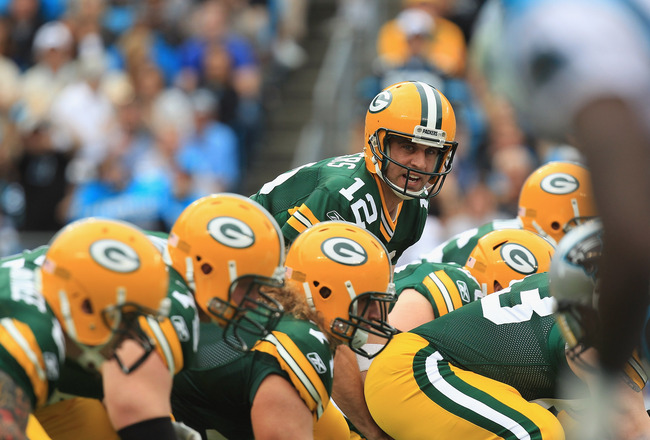 CHARLOTTE, NC - SEPTEMBER 18:  Aaron Rodgers #12 of the Green Bay Packers against the Carolina Panthers during their game at Bank of America Stadium on September 18, 2011 in Charlotte, North Carolina.  (Photo by Streeter Lecka/Getty Images)
