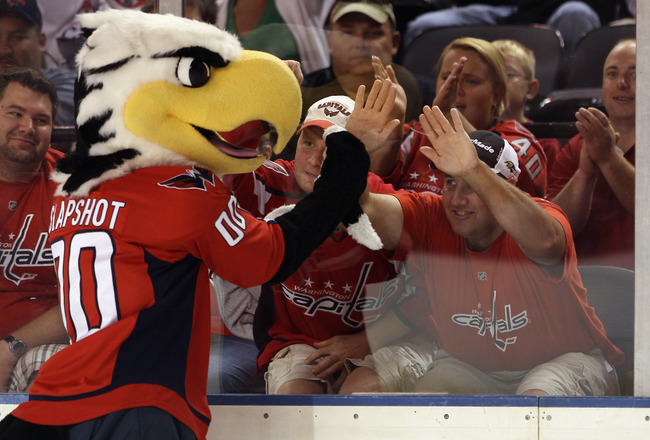 BALTIMORE, MD - SEPTEMBER 20:  The Washington Capitals mascot Slapshot toys with fans prior to the game against the Nashville Predators at the 1st Mariner Arena on September 20, 2011 in Baltimore, Maryland. The Predators defeated the Capitals 2-0.  (Photo