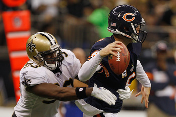 NEW ORLEANS, LA - SEPTEMBER 18:   Jay Cutler #6 of the Chicago Bears throws under pressure by  Junior Galette #93 of the New Orleans Saints at Louisiana Superdome on September 18, 2011 in New Orleans, Louisiana. The Saints defeated the Bears 30-13.   (Pho
