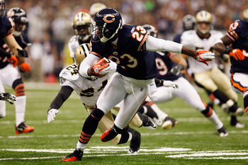 NEW ORLEANS, LA - SEPTEMBER 18:   Devin Hester #23 of the Chicago Bears avoids a tackle by  Leigh Torrence #24 of the New Orleans Saints at Louisiana Superdome on September 18, 2011 in New Orleans, Louisiana.  (Photo by Chris Graythen/Getty Images)