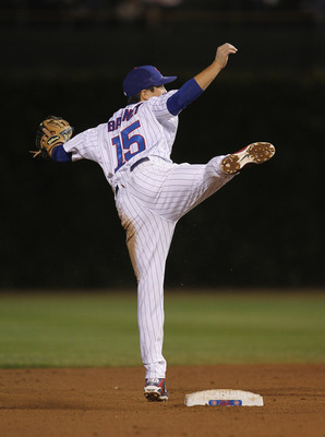CHICAGO, IL - SEPTEMBER 20: Darwin Barney #15 of the Chicago Cubs balances on one leg after attempting a double play throw against the Milwaukee Brewers at Wrigley Field on September 20, 2011 in Chicago, Illinois. (Photo by Jonathan Daniel/Getty Images)