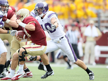 CHESTNUT HILL, MA - SEPTEMBER 03:  Brian Peters #10 of the Northwestern Wildcats sacks Chase Rettig #11 of the Boston College Eagles on September 3, 2011 at Alumni Stadium in Chestnut Hill, Massachusetts.The Northwestern Wildcats defeated the Boston Colle