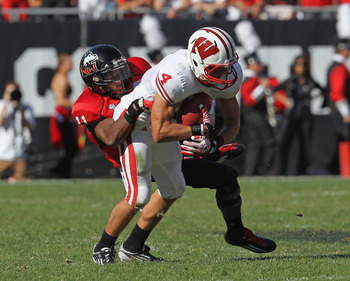 CHICAGO, IL - SEPTEMBER 17: Rashaan Melvin #11 of the Northern Illinois Huskies tackles Jared Abbrederis #4 of the Wiscon Badgers at Soldier Field on September 17, 2011 in Chicago, Illinois. Wisconsin defeated Northern Illinois 49-7. (Photo by Jonathan Da