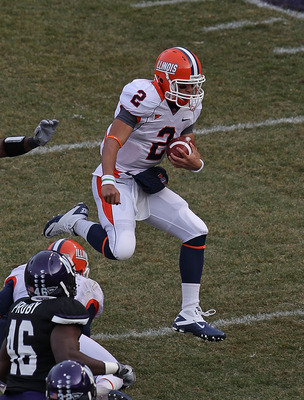 CHICAGO - NOVEMBER 20: Nathan Scheelhaase #2 of the Illinois Fighting Illini runs for a first down pursued by Nate Williams #44, Damien Proby #46 and David Arnold #32 of the Northwestern Wildcats during a game played at Wrigley Field on November 20, 2010