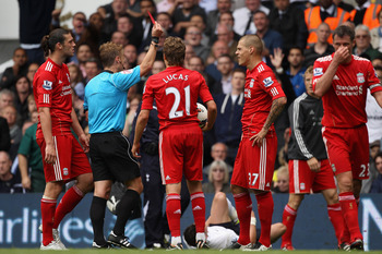 LONDON, ENGLAND - SEPTEMBER 18: Martin Skrtel of Liverpool is shown the red card and is sent off by referee Mike Jones during the Barclays Premier League match between Tottenham Hotspur and Liverpool at White Hart Lane on September 18, 2011 in London, Eng