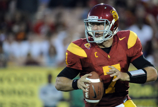 LOS ANGELES, CA - SEPTEMBER 10:  Matt Barkley #7 of the USC Trojans looks up field before his pass in the fourth quarter at Los Angeles Memorial Coliseum on September 10, 2011 in Los Angeles, California.  (Photo by Harry How/Getty Images)