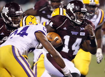 STARKVILLE, MS - SEPTEMBER 15:  Quarterback Chris Relf #14 of the Mississippi State Bulldogs scrambles for a first down past defensive back Tharold Simon #24 of the LSU Tigers in the first quarter on September 15, 2011 at Davis Wade stadium in Starkville,