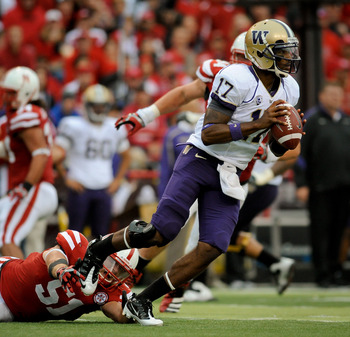 LINCOLN, NE - SEPTEMBER 17: Keith Price #17 of the Washington Huskies scans down field while avoiding J.C. Moore #52 of the Nebraska Cornhuskers during their game at Memorial Stadium September 17, 2011 in Lincoln, Nebraska. Nebraska won 51-38.(Photo by Er