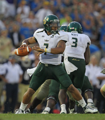 SOUTH BEND, IN - SEPTEMBER 03:  B.J. Daniels #7 of the University of South Florida Bulls throws a pass against the Notre Dame Fighting Irish at Notre Dame Stadium on September 3, 2011 in South Bend, Indiana. South Florida defeated Notre Dame 23-20.  (Phot
