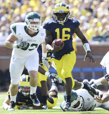 ANN ARBOR, MI - SEPTEMBER 17:  Denard Robinson #16 of the University of Michigan Wolverines runs for a short gain during the game against Eastern Michigan Eagles at Michigan Stadium on September 17, 2011 in Ann Arbor, Michigan. Michigan defeated Eastern M