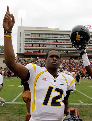 COLLEGE PARK, MD - SEPTEMBER 17: Quarterback Geno Smith #12 of the West Virginia Mountaineers celebrates after defeating the Maryland Terrapins 37-31 at Byrd Stadium on September 17, 2011 in College Park, Maryland.  (Photo by Rob Carr/Getty Images)