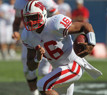 CHICAGO, IL - SEPTEMBER 17:  Russell Wilson #16 of the Wisconsin Badgers runs against the Northern Illinois Huskies at Soldier Field on September 17, 2011 in Chicago, Illinois.  (Photo by Jonathan Daniel/Getty Images)