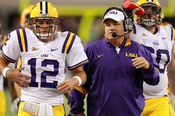 ARLINGTON, TX - SEPTEMBER 03:  Head coach Les Miles with Jarrett Lee #12 of the LSU Tigers during play against the Oregon Ducks at Cowboys Stadium on September 3, 2011 in Arlington, Texas.  (Photo by Ronald Martinez/Getty Images)