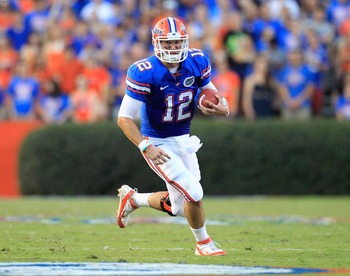 GAINESVILLE, FL - SEPTEMBER 10:  John Brantley #12 of the Florida Gators runs for yardage during a game against the UAB Blazers at Ben Hill Griffin Stadium on September 10, 2011 in Gainesville, Florida.  (Photo by Sam Greenwood/Getty Images)