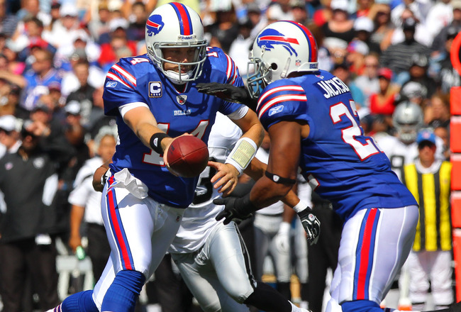 ORCHARD PARK, NY - SEPTEMBER 18: Ryan Fitzpatrick #14 of the Buffalo Bills hands the ball off to Fred Jackson #22 during an NFL game against the Oakland Raiders at Ralph Wilson Stadium on September 18, 2011 in Orchard Park, New York. (Photo by Tom Szczerb