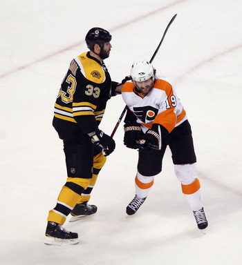 Scott Hartnell battling infront of the net with Zdeno Chara.