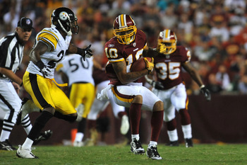 LANDOVER, MD - AUGUST 12:  Jabar Gaffney #10 of the Washington Redskins runs the ball against the Pittsburgh Steelers  at FedExField on August 12, 2011 in Landover, Maryland. The Redskins defeated the Steelers 16-7. (Photo by Larry French/Getty Images)
