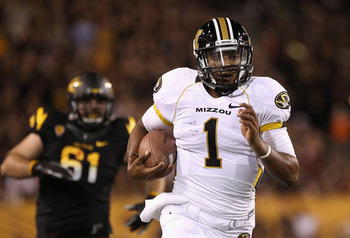 TEMPE, AZ - SEPTEMBER 09:  Quarterback James Franklin #1 of the Missouri Tigers rushes the football for 18 yards past defensive lineman Bo Moos #61 of the Arizona State Sun Devils during the first quarter of the college football game at Sun Devil Stadium