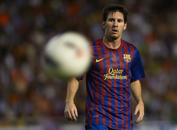 VALENCIA, SPAIN - SEPTEMBER 21:  Lionel Messi of Barcelona looks on during the La Liga match between Valencia and Barcelona at Estadio Mestalla on September 21, 2011 in Valencia, Spain.  (Photo by Manuel Queimadelos Alonso/Getty Images)