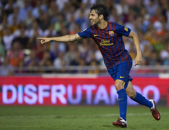 VALENCIA, SPAIN - SEPTEMBER 21:  Cesc Fabregas of Barcelona celebrates after scoring during the La Liga match between Valencia and Barcelona at Estadio Mestalla on September 21, 2011 in Valencia, Spain.  (Photo by Manuel Queimadelos Alonso/Getty Images)
