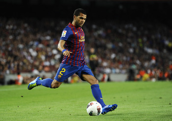 BARCELONA, SPAIN - SEPTEMBER 17:  Dani Alves of FC Barcelona runs with the balls during the La Liga soccer match between FC Barcelona and CA Osasuna at Camp Nou Stadium on September 17, 2011 in Barcelona, Spain. FC Barcelona won 8-0.  (Photo by David Ramo