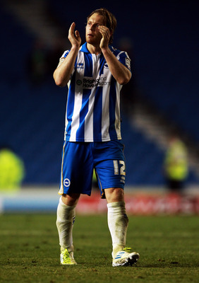 BRIGHTON, ENGLAND - AUGUST 23:  Craig Mackail-Smith of Brighton & Hove Albion applauds the fans after the Carling Cup second round match between Brighton & Hove Albion and Sunderland AFC at Amex Stadium on August 23, 2011 in Brighton, England.  (Photo by