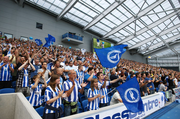 BRIGHTON, ENGLAND - AUGUST 20: Brighton & Hove Albion supporters cheer their team during the npower Championship match between Brighton & Hove Albion and Blackpool at Amex Stadium on August 20, 2011 in Brighton, England. (Photo by Brendon Thorne/Getty Ima