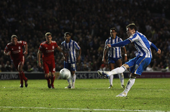BRIGHTON, ENGLAND - SEPTEMBER 21:  Ashley Barnes of Brighton & Hove Albion scores their first goal from the penalty spot during the Carling Cup Third Round match between Brighton & Hove Albion and Liverpool at the American Express Community Stadium on Sep