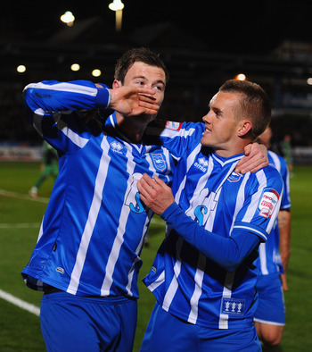 BRIGHTON, ENGLAND - APRIL 12:  Ashley Barnes of Brighton celebrates with team mate Craig Noone after scoring the winner during the npower League One match between Brighton & Hove Albion and Dagenham & Redbridge at Withdean Stadium on April 12, 2011 in Bri