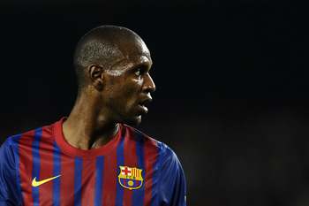 BARCELONA, SPAIN - SEPTEMBER 17:  Eric Abidal of FC Barcelona looks on during the La Liga soccer match between FC Barcelona and CA Osasuna at Camp Nou Stadium on September 17, 2011 in Barcelona, Spain. FC Barcelona won 8-0.  (Photo by David Ramos/Getty Im
