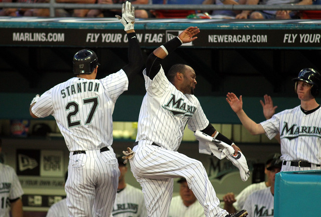 MIAMI GARDENS, FL - SEPTEMBER 19:  Mike Stanton #27 of the Florida Marlins celebrates a solo home run with teammate Emilio Bonifacio #1 against the Atlanta Braves  at Sun Life Stadium on September 19, 2011 in Miami Gardens, Florida.  (Photo by Marc Serota