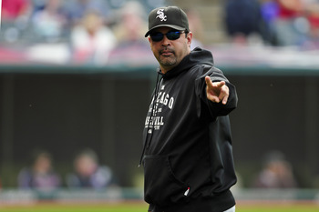 CLEVELAND, OH - SEPTEMBER 20: Manager Ozzie Guillen #13 of the Chicago White Sox waves the peace sign to a fan during the eighth inning against the Cleveland Indians at Progressive Field on September 20, 2011 in Cleveland, Ohio. The Indians defeated the W