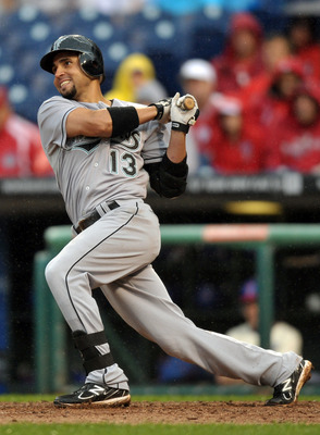 PHILADELPHIA, PA - SEPTEMBER 15: Omar Infante #13 of the Florida Marlins hits a double in the eighth inning during the game against the Philadelphia Phillies at Citizens Bank Park on September 15, 2011 in Philadelphia, Pennsylvania. The Phillies won 3-1.