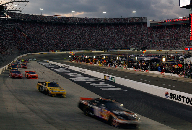 BRISTOL, TN - AUGUST 27:  Denny Hamlin, driver of the #11 FedEx Express Toyota, leads a line of cars during the NASCAR Sprint Cup Series Irwin Tools Night Race at Bristol Motor Speedway on August 27, 2011 in Bristol, Tennessee.  (Photo by Chris Graythen/G