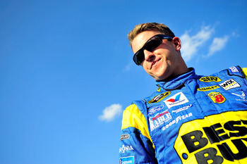 CHARLOTTE, NC - MAY 20:  A.J. Allmendinger, driver of the #43 Best Buy Ford, looks on during qualifying for the NASCAR Sprint Showdown at Charlotte Motor Speedway on May 20, 2011 in Charlotte, North Carolina.  (Photo by Jason Smith/Getty Images for NASCAR