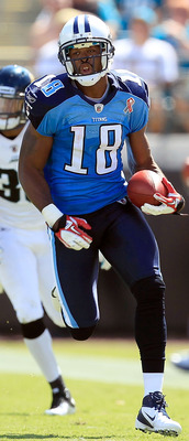 JACKSONVILLE, FL - SEPTEMBER 11:  Kenny Britt #18 of the Tennessee Titans runs for yardage during the season opener game against the Jacksonville Jaguars at EverBank Field on September 11, 2011 in Jacksonville, Florida.  (Photo by Sam Greenwood/Getty Imag
