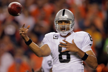 DENVER, CO - SEPTEMBER 12:  Quarterback Jason Campbell #8 of the Oakland Raiders throws the ball in the first quarter against the Denver Broncos at Sports Authority Field at Mile High on September 12, 2011 in Denver, Colorado.  (Photo by Doug Pensinger/Ge